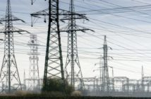 49994447 - electricity pylons with distribution power station blue cloudy sky