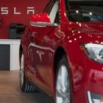 Cars on display inside the Tesla Gallery and Service Center in  Paramus, U.S., on Thursday, Dec. 11, 2014. Photographer: Ron Antonelli/Bloomberg *** Local Caption ***